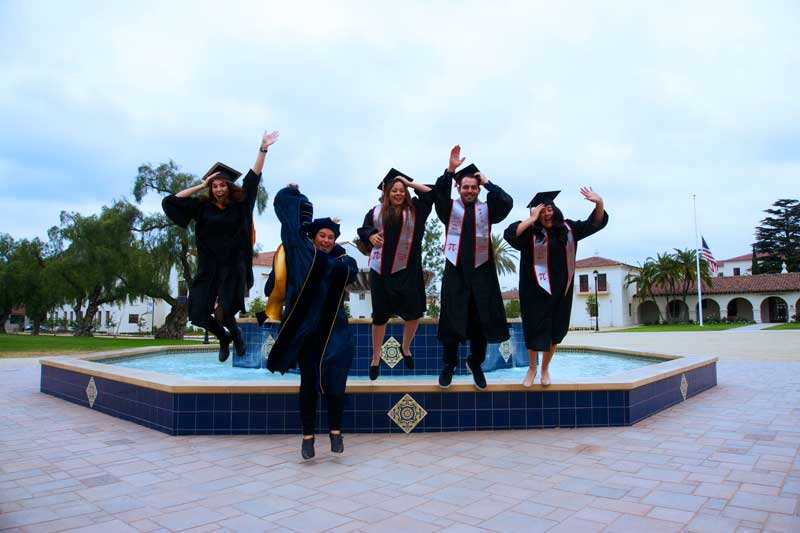Graduates jumping off Central Mall fountain