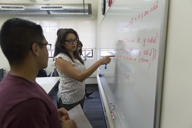 students and instructor at white board
