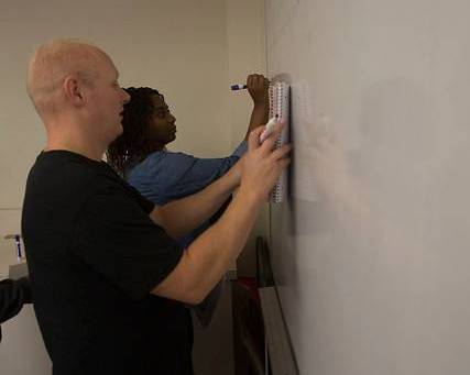 students working at white board